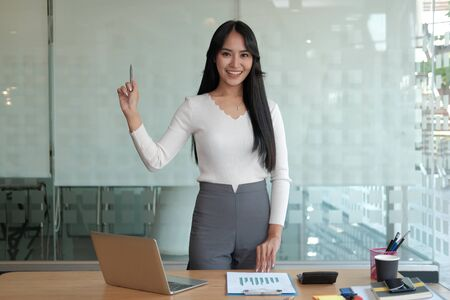 young confident asian executive businesswoman woman smiling at business workplace Stock Photo