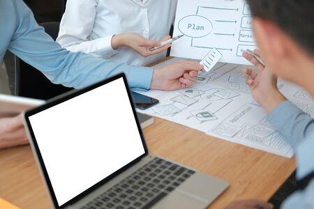 user experience UX designer designing web on smart phone layout. UI planning mobile application. developer work with business prototype Reklamní fotografie - 135127133