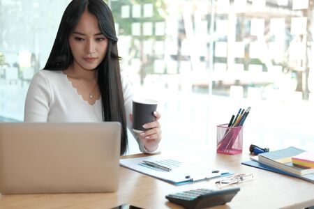 businesswoman freelancer working with computer at office. startup woman entrepreneur analyzing data at workplace. student studying doing assignment