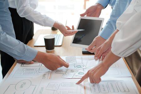 user experience UX designer designing web on smart phone layout. UI planning mobile application. developer work with business prototype Reklamní fotografie - 135128801