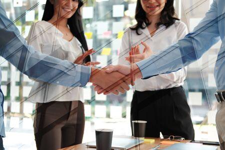 businessman shaking hands after meeting. Business people handshaking. Greeting deal, teamwork partnership concept. Reklamní fotografie - 135131758