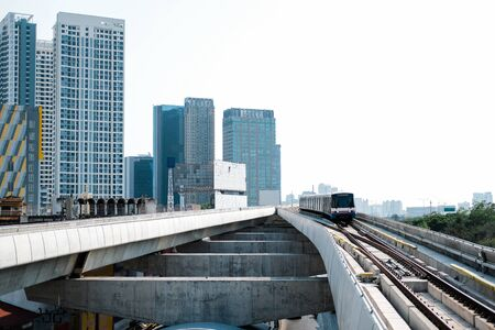 BTS sky train coming to station in Bangkok, Thailand