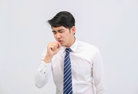 ill businessman man feeling sick, sneezing coughing from cold flu virus bacteria infection pollution Stock Photo
