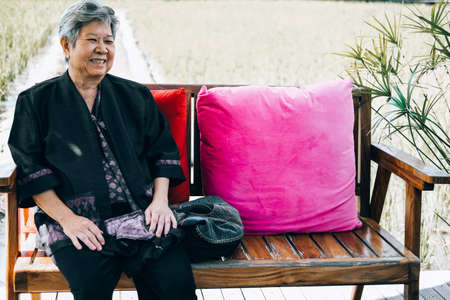 asian elderly woman elder  resting relaxing outdoors. senior leisure lifestyle Stock Photo