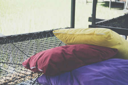 black thread rope net bed pillow for sleeping beside rice paddy field Stock Photo