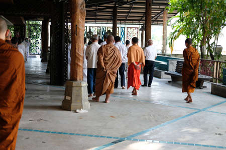 Chiang Mai, Thailand -  November 18, 2020: buddhist monk and people walking for mindfulness meditation at Khumphucome hotel in Chiang Mai, Thailand on November 18, 2020