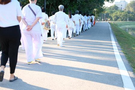 Chiang Mai, Thailand -  November 19, 2020: buddhist people walking for mindfulness meditation at Chiang Mai university in Chiang Mai, Thailand on November 19, 2020
