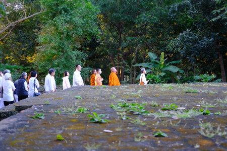Chiang Mai, Thailand -  November 20, 2020: buddhist monk and people walking for mindfulness meditation at Chiang Mai university in Chiang Mai, Thailand on November 20, 2020 Redakční