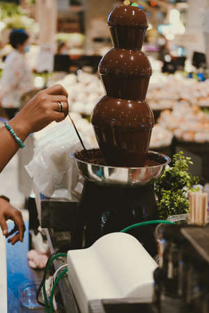 chocolate fondue fountain dripping sauce for dipping fruit