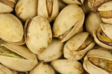 A close-up shot of pistachio nuts.  Great for a background or desktop. Stock Photo