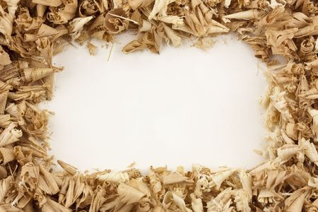 shavings: A frameborder of wood shavings around a blank white center Stock Photo