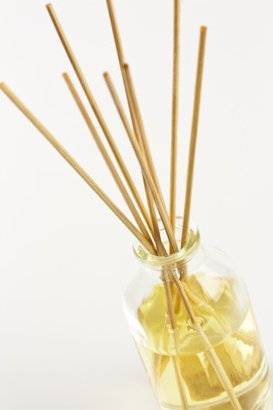 disperse: A glass jar of aromatherapy oil with bamboo sticks to disperse the scent