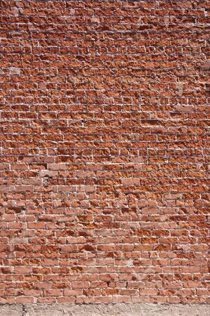 brick: Textured red brick wall background