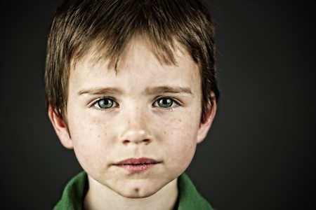 cousin: Boy with green eyes Stock Photo