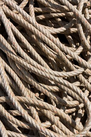 coiled rope: Background image of rope, coiled and used Stock Photo