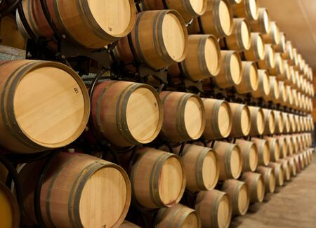 stacked up: Oak wine barrels stacked up in a winery aging room