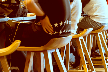 Boy group sitting on the wooden chair in coffee shop