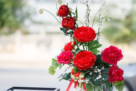 wedding table setting: Batch of red carnation flower in glass
