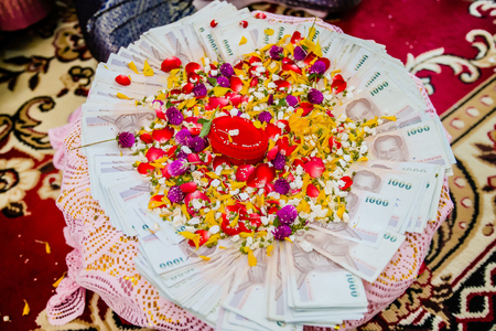 dowry: Dowry (money) on flower tray in Thai traditional wedding