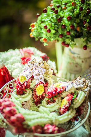 Flower garland for bride and groom Stock Photo - 76373969