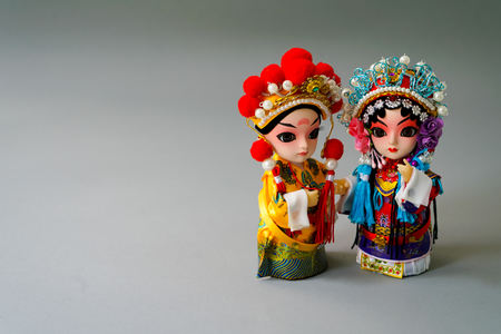 happy woman: Traditional married Chinese dolls isolate on gray background Stock Photo