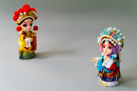 funny baby: Traditional married Chinese dolls isolate on gray background Stock Photo
