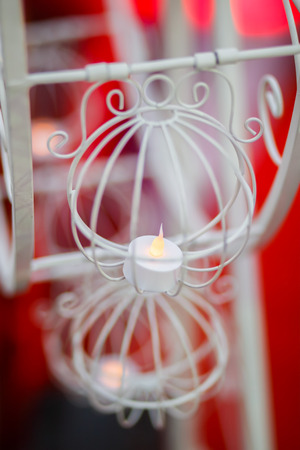 Blurred background of the candle in the wheel vintage basket