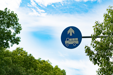 Truck entrance allowed sign on the blue sky and tree Stock Photo