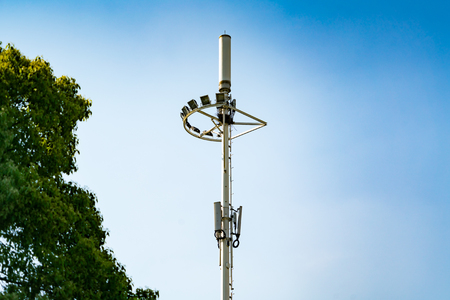 cell phone transmitter tower: communication tower pole, mobile, internet 4G, wifi with blue sky background