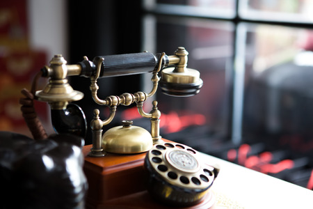 receiver: Black gold antique vintage telephone, abstract of communication