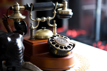 Black gold antique vintage telephone, abstract of communication
