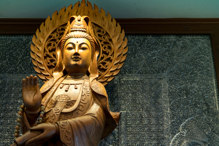 the engrave of gold wooden Guan Yin