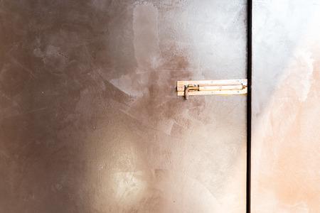 focus on door latch unlock on the brown wall