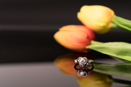 the diamond ring with tulips flower backgrounds, luxury rings with copy space