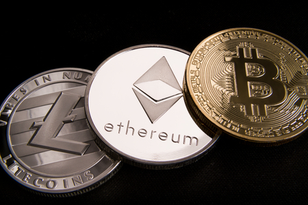 stock of physical bitcoins, btc, bitcoin, ethereum, litecoins, gold and silver coins, cryptocurrency concept