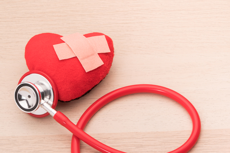 stethoscope and red heart symbol, healthcare and medicine, healthy and insurance, world health day concept Stock Photo