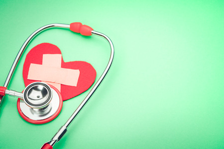 healthcare and medicine stethoscope and red heart symbol healthy and insurance world health day concept
