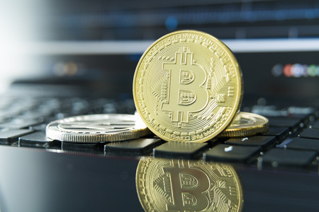 cryptocurrency coins - Litecoin, Bitcoin, Ethereum, Ripple cryptocurrency concept stock of physical bitcoins gold and silver coins