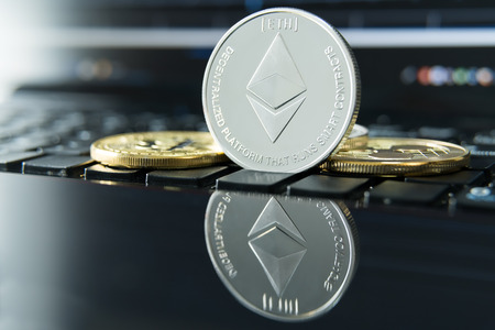 cryptocurrency coins - Ethereum, Litecoin, Bitcoin, Ripple cryptocurrency concept stock of physical bitcoins gold and silver coins Stock Photo