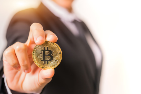 cryptocurrency coins - Bitcoin, Ethereum, Litecoin, Ripple. Women hold the cryptocurrency coin on hand. Physical bitcoins gold and silver coins