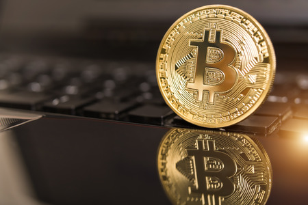 cryptocurrency coins - Bitcoin, Litecoin, Ethereum, Ripple cryptocurrency concept stock of physical bitcoins gold and silver coins