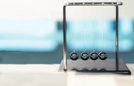 Balancing Balls Newton's Cradle on blurred backgrounds