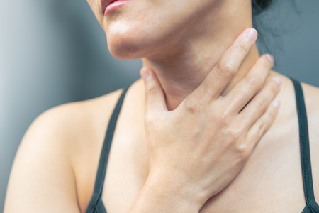 Sore throat pain women. Woman hand touching neck with sore throat feeling bad. Healthcare and medicine concept