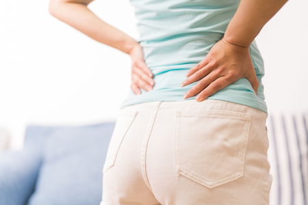 back pain at home. women suffer from backache. healthcare and medical concept Stock Photo