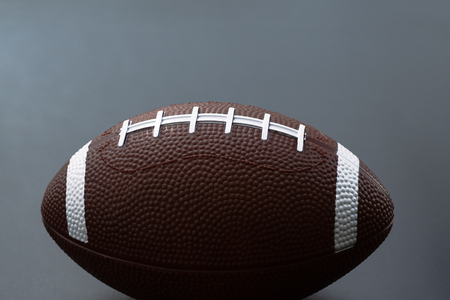 American football isolated on black background . Sport object concept