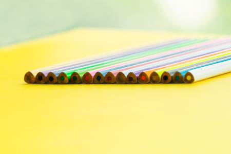 Diversity concept. row of mix color pencil on yellow background