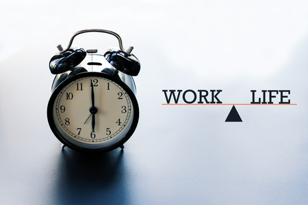work life balance concept, alarm clock with word Work and Life on illustration scale