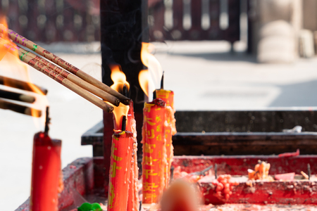 Longhua temple in Shanghai, China. lighting the candle to pray to Buddha