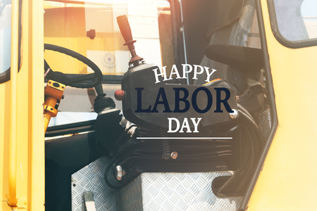 Labor Day Concept. excavator driver seat closeup with word Happy Labor Day