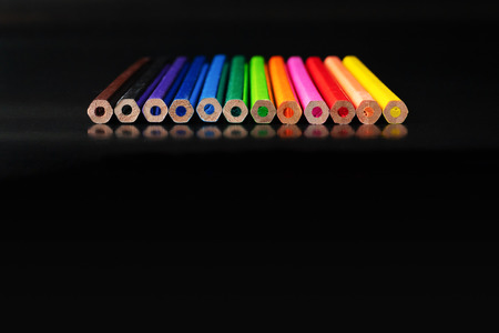 Diversity concept. row of mix color pencil on black background with text Diversity, Ethnicity, Equality, Age, Sexual Orientation 版權商用圖片 - 110343166